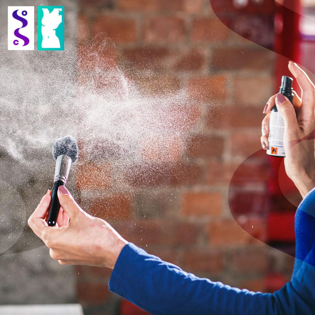 woman spraying makeup brush