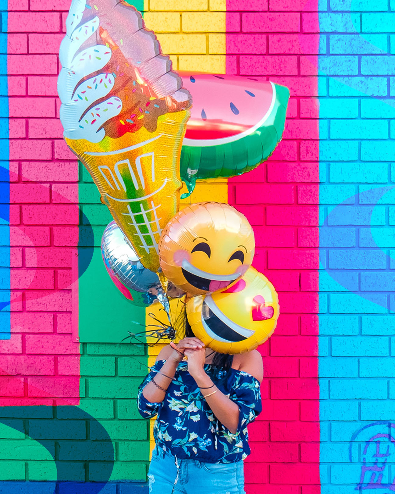 woman holding up balloons